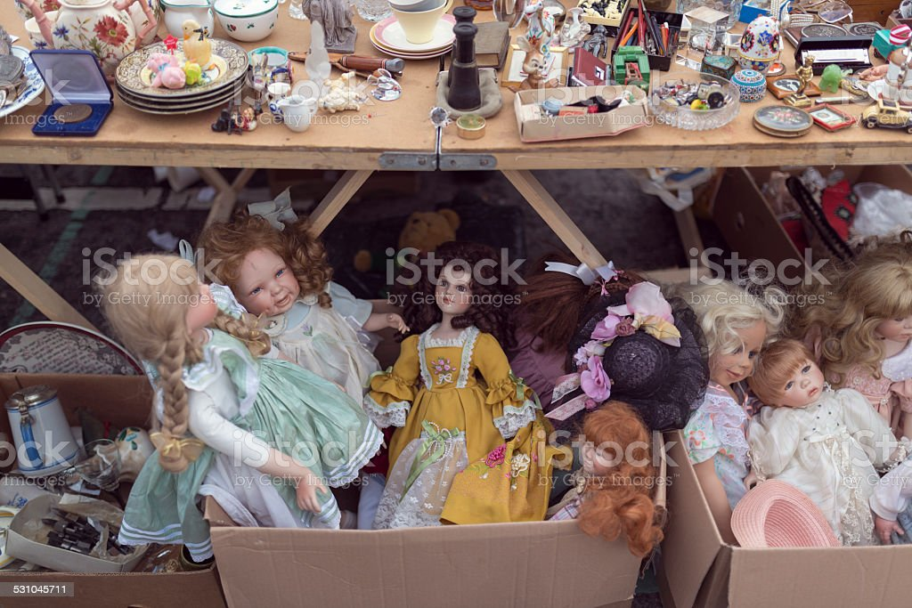 vintage dolls at a flea market stock photo