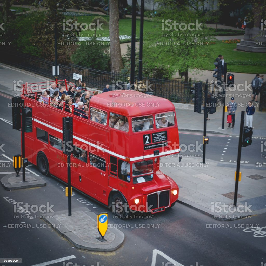 A vintage double-decker red bus use for city sightseeing in central London (UK). stock photo