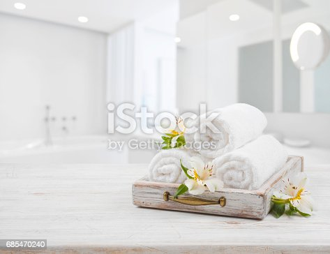 istock Vintage drawer, spa towels and orchid flowers over blurred bathroom 685470240