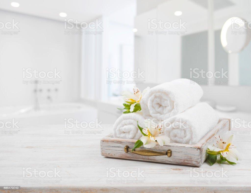 Vintage drawer, spa towels and orchid flowers over blurred bathroom - foto de acervo