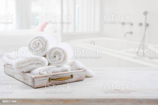 Vintage drawer with white towels over blurred bathroom and bedroom picture id688527558?b=1&k=6&m=688527558&s=612x612&h=o5xzcmaodw7op pdknk6kvobxlbcxo4mpajvyiysm w=