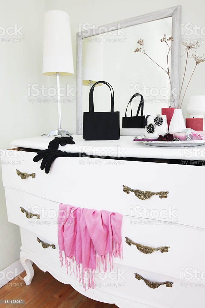 Vintage dresser with opened drawers and hanging clothes stock photo