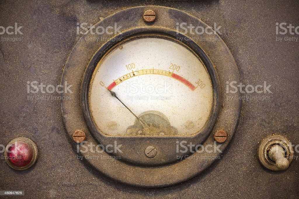 Vintage dusty volt meter in a metal casing stock photo