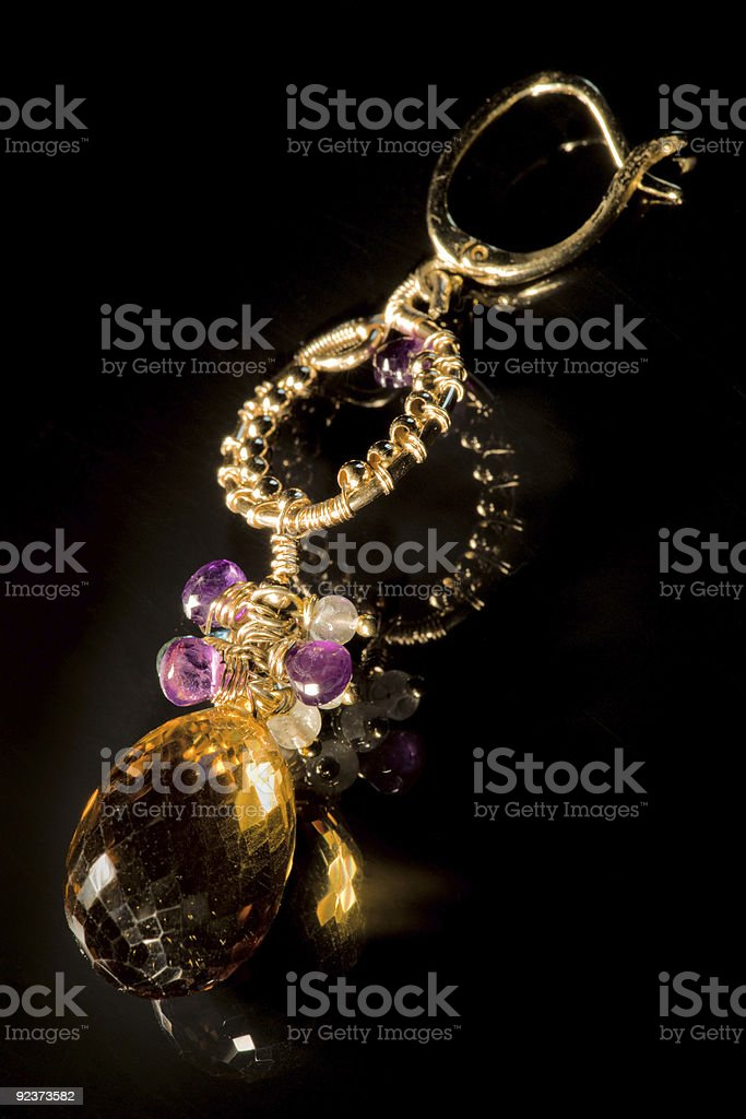 Vintage earring with semi-precious stones royalty-free stock photo