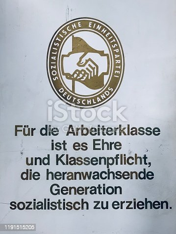 Text says in German: For the working class, it is honor and class compulsory to educate the adolescent generation in socialism.