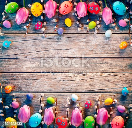 istock Vintage Easter Decoration - Painted Eggs With Willows Branches And Tulips On Rustic Table 1304923433