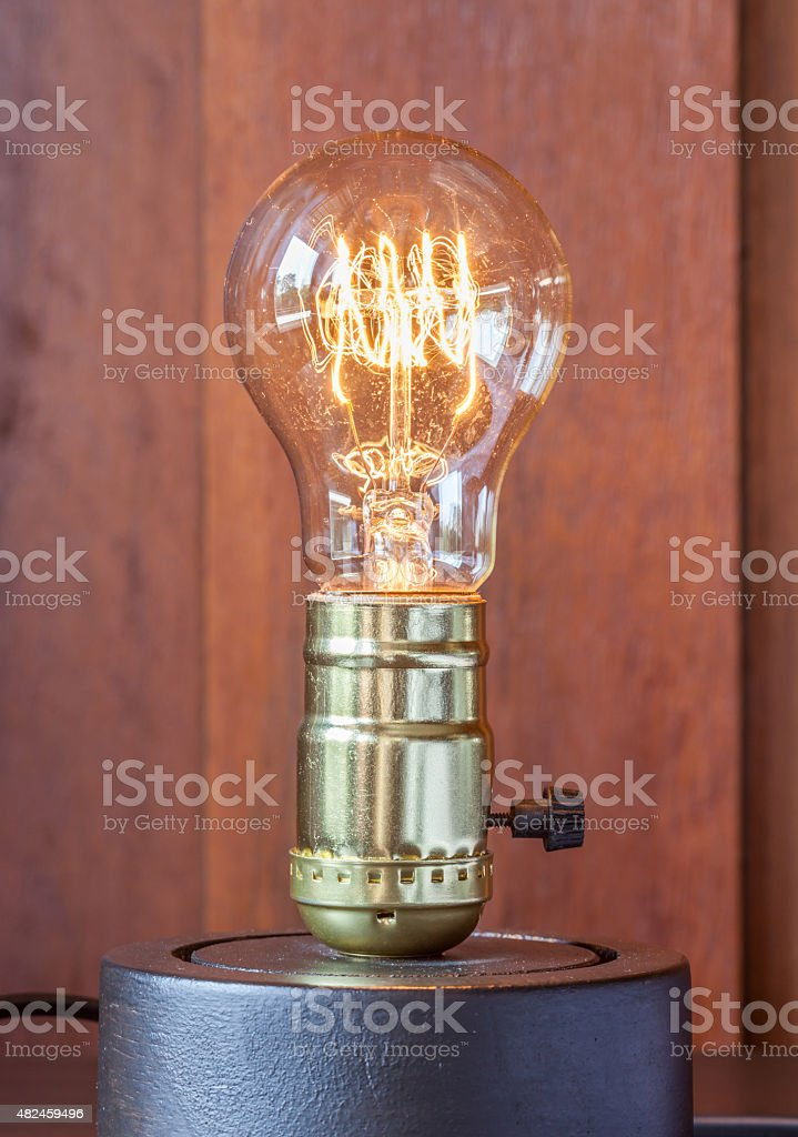 vintage edison light bulb with wood background for hotel decoration royalty free stock photo