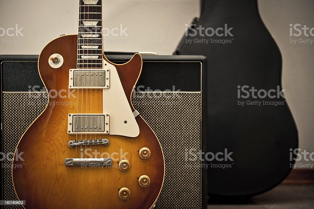 Vintage Electric Guitar with amplifier and bag stock photo