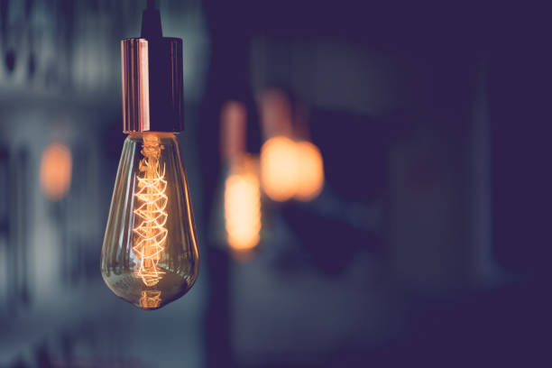 vintage electric light.decorative antique edison style light bulbs in coffee shop.vintage tone - light bulb stock pictures, royalty-free photos & images