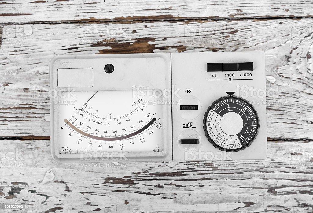 Vintage electrical multimeter on wooden table. stock photo