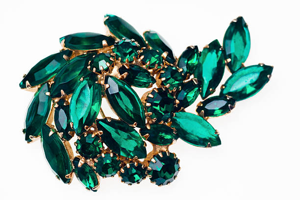 Vintage emerald green brooch isolated on a white background stock photo
