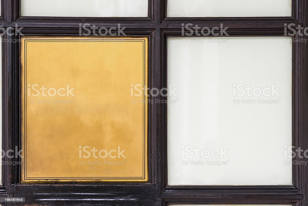 Vintage empty yellow metal sign in wood royalty-free stock photo