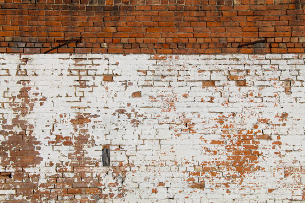 vintage exterior natural red whitewashed brick wall stock photo