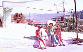 Vintage image of a mother and her children in a little mexican town during a summer vacation in the seventies.