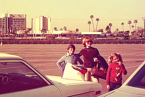 Vintage image of a mother and her children on a sunny day
