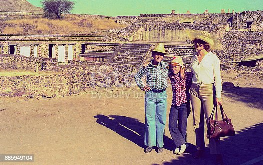 Vintage photo featuring a mother and her children in an archeological site during a trip to Mexico in the eighties.