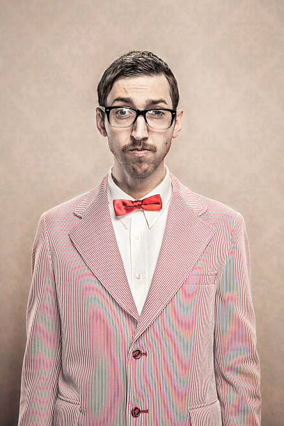 vintage fancy dressed Nerd with bow tie and glasses stock photo