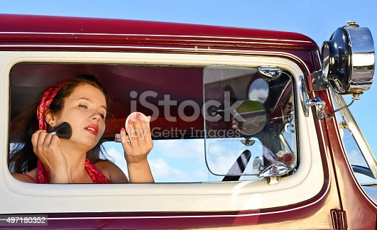 Beautiful Russian girl during vintage fashion and classic car show in Auckland, New Zealand.