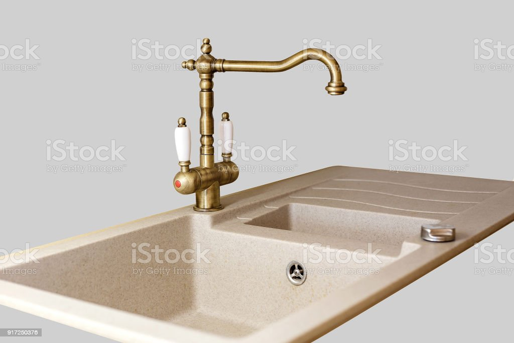 vintage faucet from the sink. stock photo
