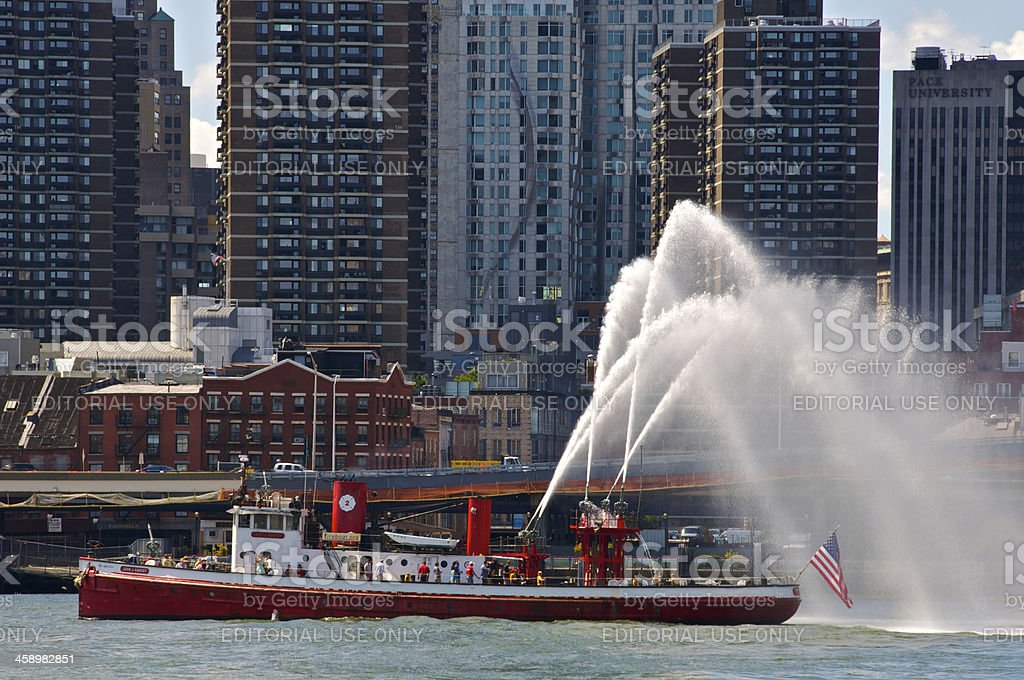 Vintage FDNY Fire Boat shooting water, East River, Manhattan, NYC stock photo