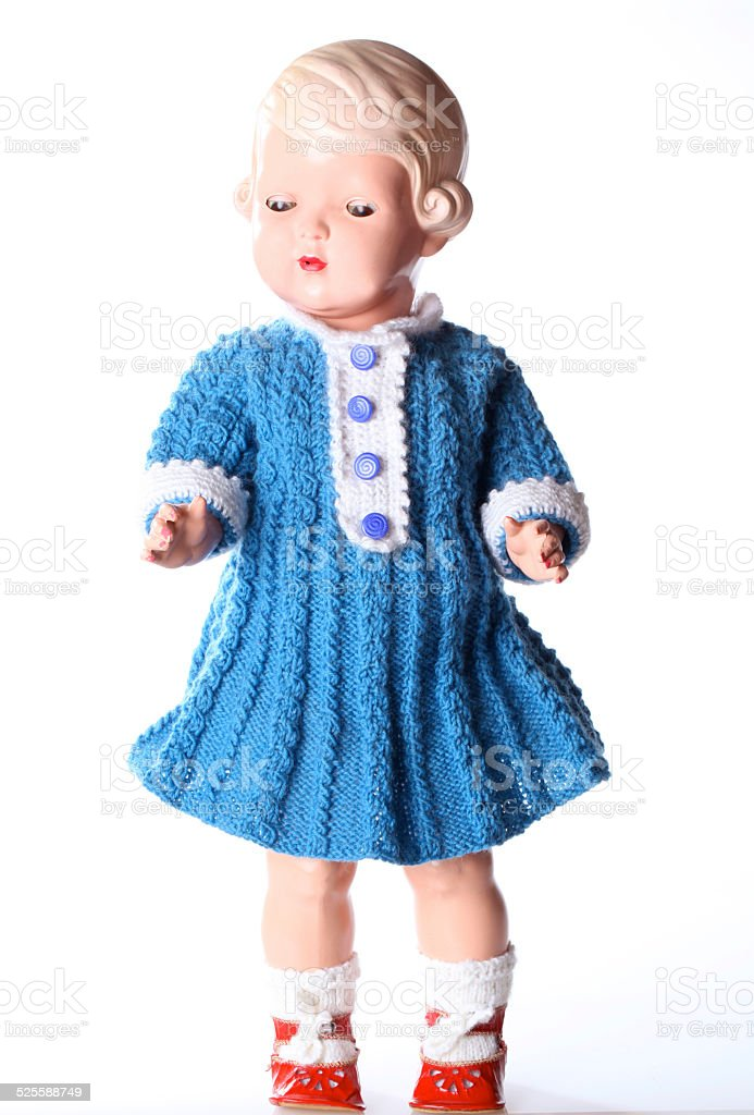 Vintage female doll from 1952 with blue knitting dress stock photo