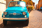 Vintage Fiat 500 classic italian car parked Trastevere, Rome, Italy