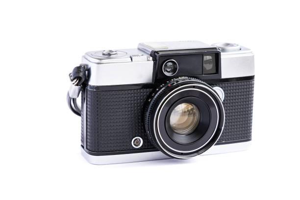 Vintage film camera isolated on white background. stock photo