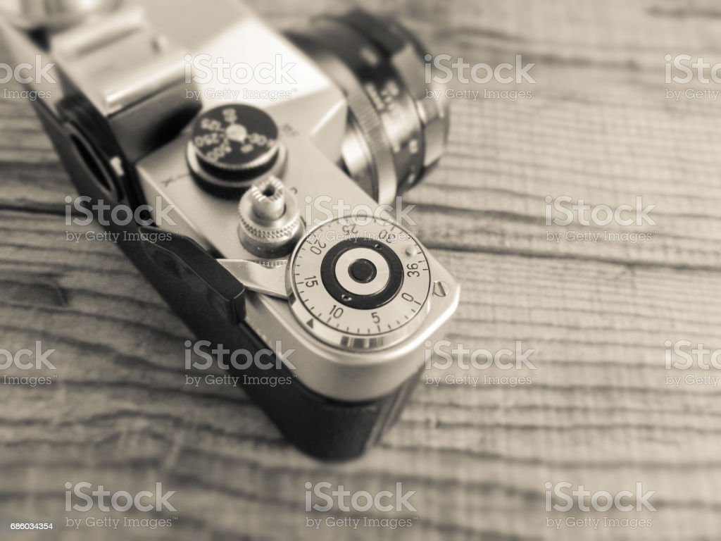 vintage film camera made in urss lying over a dated wooden