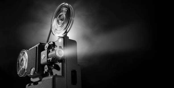 Vintage film projector and film screening stock photo