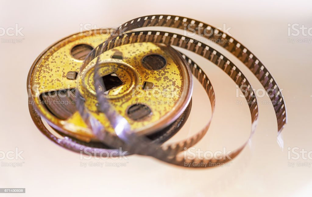 Vintage film spool vintage 8 mm cinema background stock photo