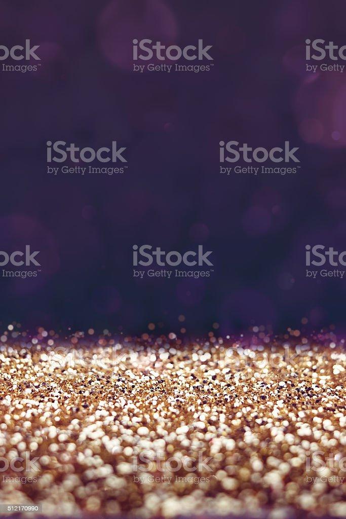 Vintage filter, Gold glitter floor with purple bokeh background,...