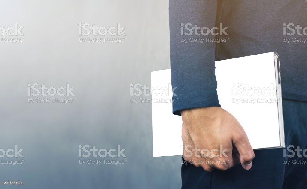 Vintage filter on white empty book cover holding by man on grey background stock photo