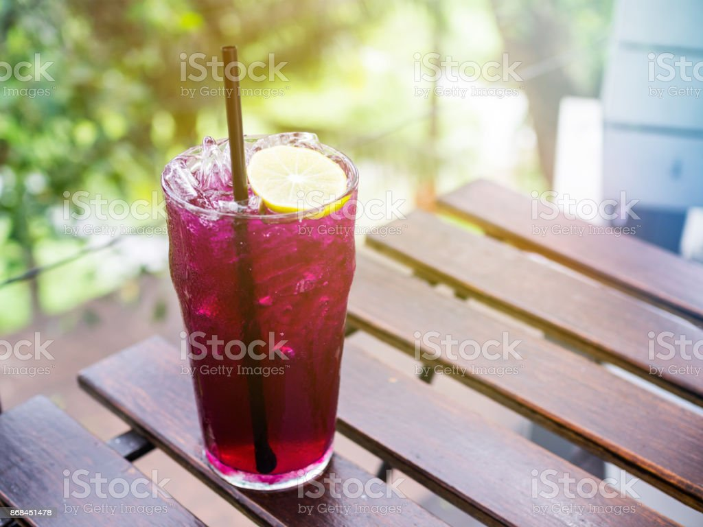Vintage filtered on butterfly pea flower juice with sliced lemon decoration stock photo
