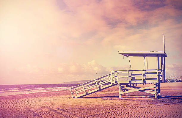 Vintage filtered picture of lifeguard tower, California, USA. Vintage filtered picture of wooden lifeguard tower at sunset, beach in California, USA. santa barbara california stock pictures, royalty-free photos & images