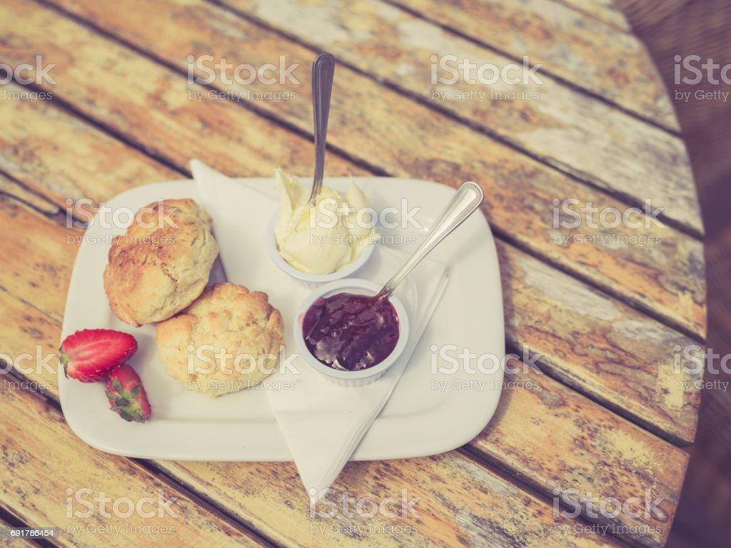 Vintage filtered shot of cream tea on table stock photo