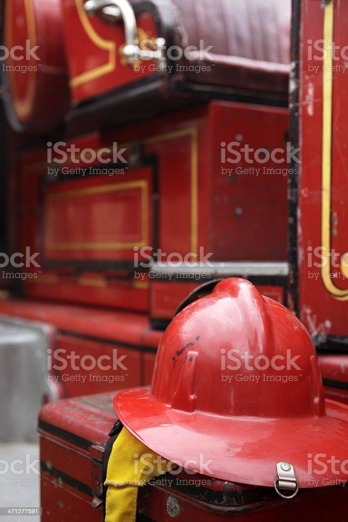 Vintage Fire Helmet and Firetruck stock photo