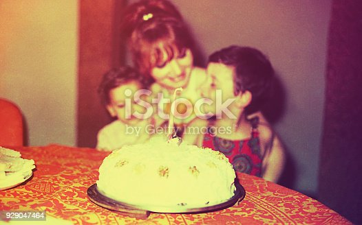 Vintage image of a mother and her children in thedaughter first birthday day.