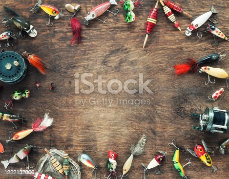 Vintage Fishing Lures on an Old Wood Background