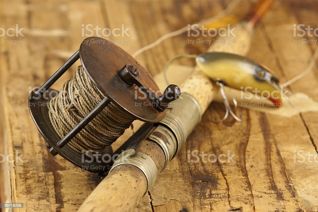 Vintage fishing rod and reel stock photo