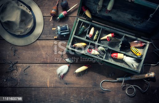 Vintage fishing lures/tackle on an old wood background. Aerial view