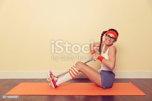 A female nerd is building muscle the old-fashioned way—through sweat and tears. Exercise has never been so fun.