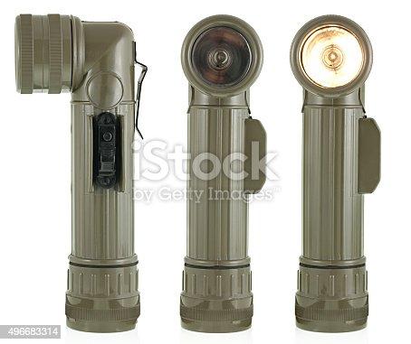 Vintage flashlight. Military old flashlight. One of the symbols of Vietnam War.