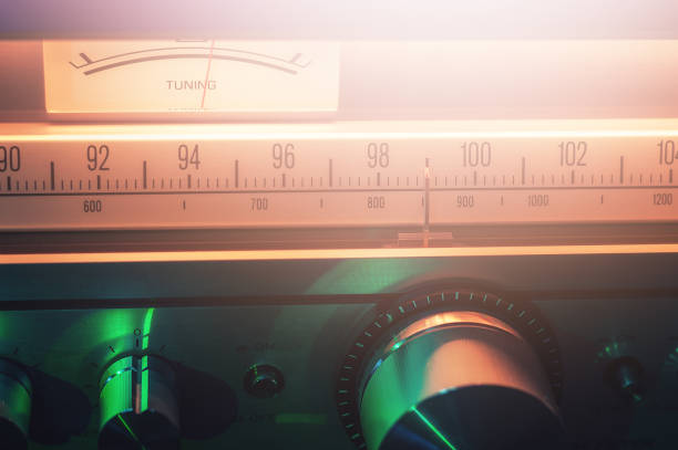 Vintage FM radio tuner with scale and volume meter close up shot stock photo