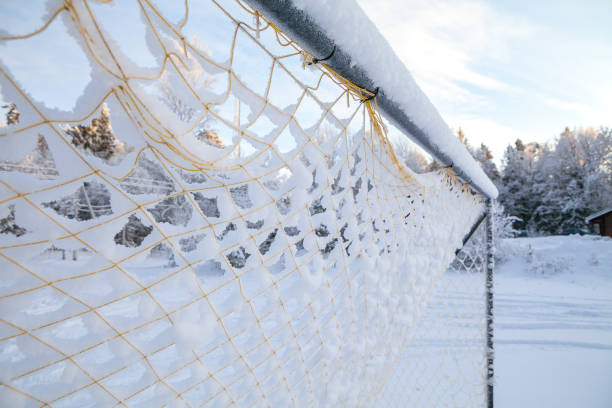 Vintage football goal net, covered with snow stock photo