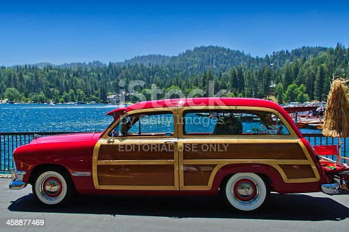 Lake Arrowhead, USA - June 9, 2012: Vintage 1950s red Ford Woody parked waterside at annual vintage car and boat show in the mountains above Los Angeles.