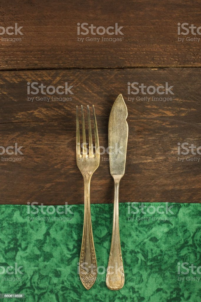 Vintage fork and knife for copyspace, overhead shot royalty-free stock photo
