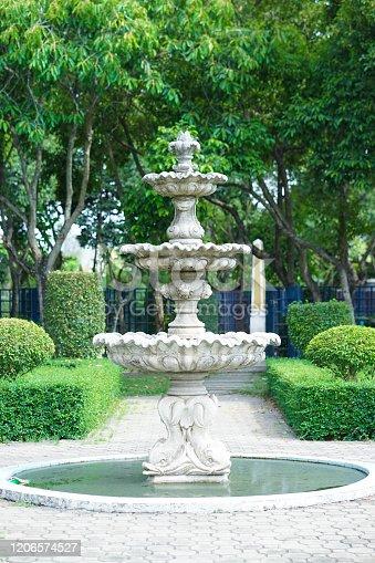 Vintage fountain. An old vintage park fountain in the outdoor garden.