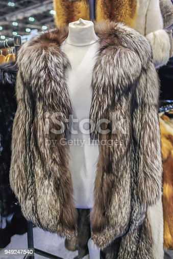 Vintage long haired fox fur jacket with luxurious collar on a dummy model.