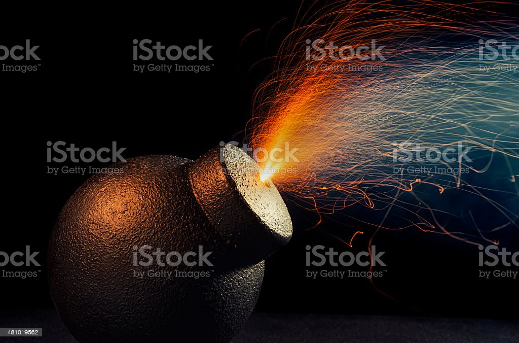 Vintage fragmentation bomb at the end of it's fuse stock photo
