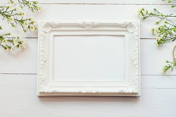 Vintage frame on white wooden background stock photo